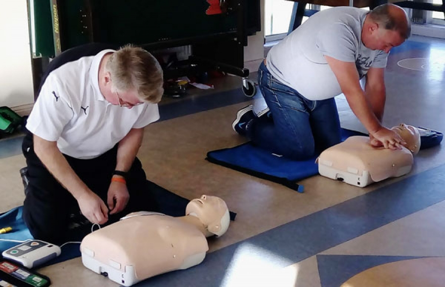 Members learn how to use defibrillator
